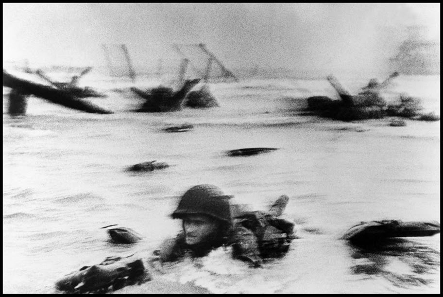 Normandy, Omaha Beach, June 6th, 1944. One of Robert Capa's most famous images from D-Day.
