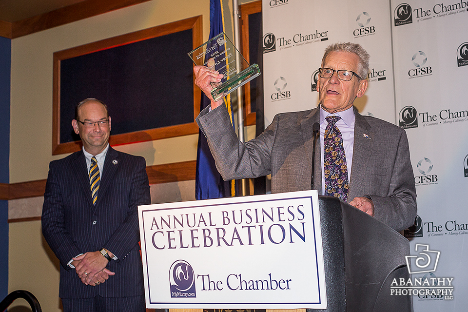 """Terry Little (right) received the """"2015 Citizen of the Year"""" award Friday night at the annual Murray/Calloway County Chamber of Commerce Business Celebration Dinner. Pictured left is award presenter Chris Wooldridge, director of the Murray State University Small Business Development Center."""