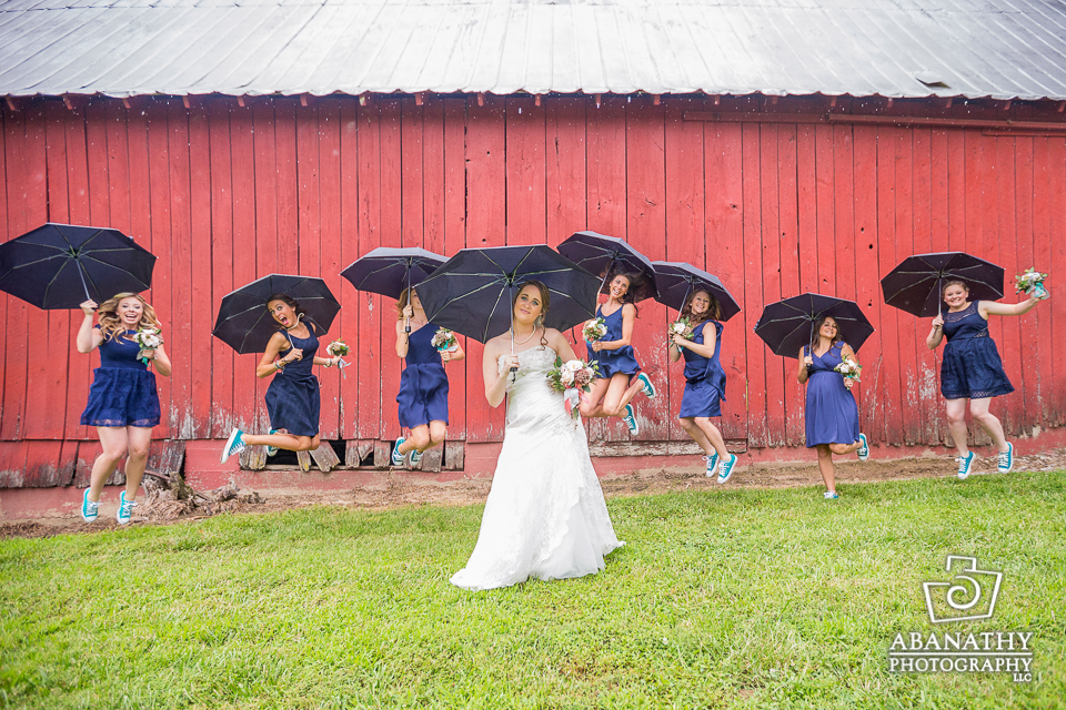BEFORE: The rain hit just as the bridal party was ready for their portraits. Luckily, a bag of umbrellas saved the day!